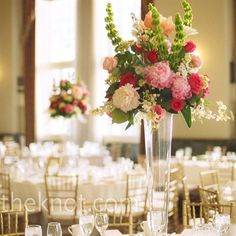 To create dramatic focal points on the tables, the bride's mother designed tall, oversized arrangements with pink and green blooms, like full peonies and bells of Ireland.