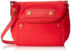 A Marc by Marc Jacobs handbag in the classic Natasha shape. Featuring a patch pocket and a logo patch detail the front, and the flap unzips for extra storage. The leather strap adjusts to customize...
