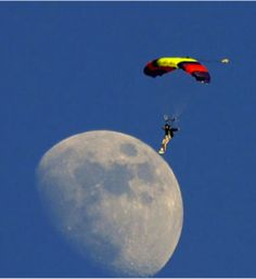 Funny photos, perfectly timed photos, man lands on moon parachute