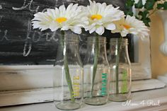 Stenciled Glass Bottle Vases - love this look. Instead of painting will try with Silhouette vinyl