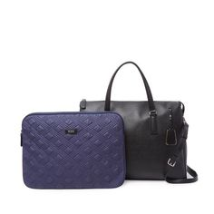 """Tumi Women's Briefcase - Black and Silver Like new only used twice, separate zipper pocket for computer, slides onto suitcase handle, silver zippers and purple interior. Great feminine but professional computer bag! Length 15 1/2"""", height 12"""", width 5 1/2"""", drop handle 5"""", strap drop 17 1/2"""" Tumi Bags Laptop Bags"""