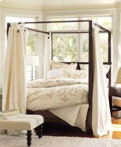 four poster bed... I like the curtains along the posts...