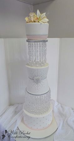 Three tier elegant wedding cake with crystal stands