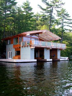 This one has a boat garage underneath.   28 Houseboats That Will Make You Want To Float Away