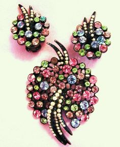 Hey, I found this really awesome Etsy listing at https://www.etsy.com/listing/172888427/vintage-art-mode-rhinestone-brooch-and