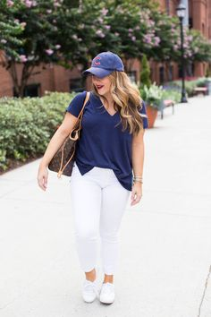 A basic tee is one of the best things you can have in your wardrobe. Click through for more on this casual summer outfit and to shop the best tee EVER. | white jeans outfit | simple tee outfit | how to wear a baseball cap | how to style a baseball cap | cute baseball hat outfit | casual summer outfit | summer outfit idea | summer outfit inspiration