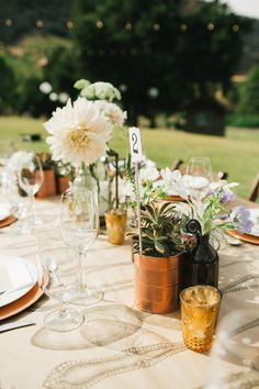 copper + succulent centerpieces // photo by Sweet Little Photographs, styling by Sitting in a Tree Events, flowers by The Little Branch // View more: http://ruffledblog.com/copper-and-white-malibu-wedding/