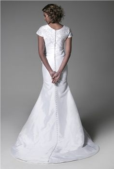 The Bristol Modest Wedding Dress looks lovely on any bride, but especially flatters more curvy brides. The bateau neckline on the Bristol Modest Wedding Dress is an elegant classic; it is not so modest that it is stifling, but gives you peace of mind so that you are not worried about having anything show that shouldn't.