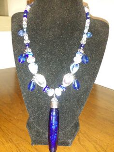 Friendship Vial. Filled with crystal beads in clear,light blue,blue,grape purple and pink.