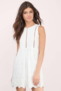Beautiful white shift dress with a plunging back detail for a flattering appeal. Pair with boots or heels to dress it up for your next outfit.