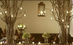 Branch centerpieces for weddings are simple and elegant. With either small hanging votive candles or strands of chrystals.