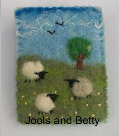 This lovely little brooch has been made with felt (made by me!), using the wet-felting method. The sheep have been needlefelted on, using fleece from my own Shetland sheep! The brooch was then finished off with some handstitching. It has a brooch pin, with a safety catch, on the back. The brooch is made from … Wool Needle Felting, Wet Felting, Felted Wool Crafts, Felt Crafts, Felt Brooch, Brooch Pin, Sheep Cards, Felt Squares, Felt Bookmark