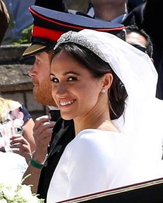 The newlyweds Prince Harry, Duke of Sussex and Meghan, Duchess of Sussex waved to the well wishers gathered outside the chapel after exchanging vows