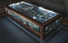 40 Cool Coffee Tables via Brit + Computer Board Table: Nerd alert! We love the glowing orb of this table. (via The News Is Broken) Coffee Table Design, Unique Coffee Table, Cool Coffee Tables, Coffe Table, Tables Cool, Creative Coffee, Computer Board, Gaming Computer, Computer Built Into Desk