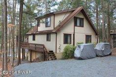 Well Maintained Lake Front Chalet. Many recent improvements and upgrades. Move right in and enjoy Lake Front living. Home is located on a non-power boating lake but has lake rights to two others, including Lake Wallenpaupack. Relax by your stone fireplace or on the deck overlooking the water. Finished lower level offers family room with game area. Other amenities includes multiple pools, sports, beaches, and much more!! Many of the furnishings can be included if desired.
