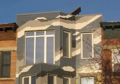 The owner and designer behind Queens', NY first ever energy-efficient 'passive house' rebuffed critics of the three-story home's Lego-like façade Tuesday.