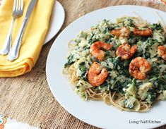 Healthy Shrimp Pasta - whole wheat pasta covered in a spinach & artichoke sauce made with Greek yogurt, then topped with sauteed shrimp.