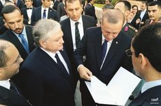 In this image taken from the Armenian Foreign Ministry website, President Erdoğan looks at the invitation given by Foreign Minister Nalbandian.
