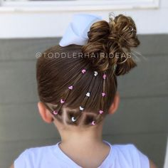 "Toddler hair ideas ""Diagonal ponies with accent elastics up to a high side messy bun!"