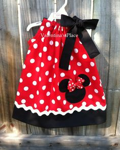 Minnie Mouse in red and white polka dot pillowcase dress (Also available in pink). $27.00, via Etsy.
