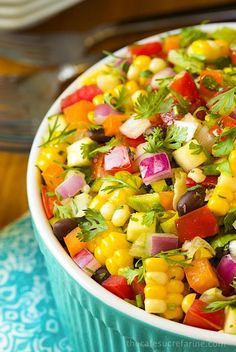Closeup photo of a turquoise bowl of Mexican Chopped Salad.