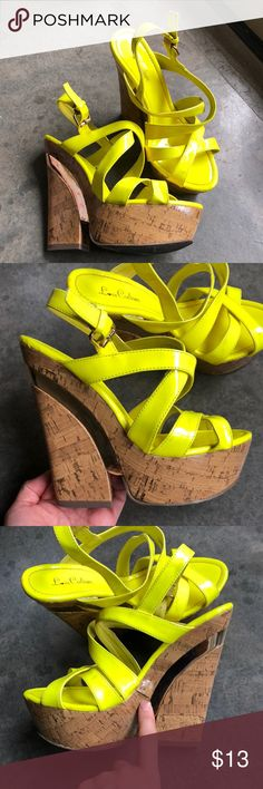 Neon Platforms These fun wedges have been worn, but, minimally. The sticker says 8 but I think the fit 7 1/2 or a very snug 8. There are a few spots on them, darker, could be stains in the material. There are a some scuffs on the gold wedge part and the neon part, & a place where the material is detached - see pictures closely please. I will wipe them before I send to clean as best as possible. If you need more pictures let me know! Ask any questions otherwise sold as is. Shoes Heels