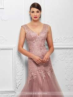 117D65 - Tulle and lace trumpet gown with lace trimmed illusion slight cap sleeves, front and back illusion V-necklines, sweetheart dropped waist lace bodice with light hand-beading, horsehair hemline. Matching shawl included.