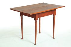 "QUEEN ANNE TAVERN TABLE.   New England, 18th century, maple. Rectangular top over turned legs ending in pad feet. Old red wash. 26.5""h. 37""w. 24""d."