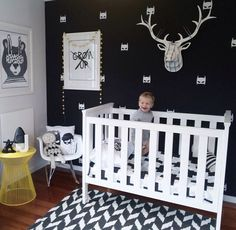 Hip kid room design. Urban walls. Love the antlers and Batman!