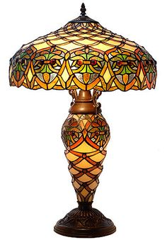 This elegant Tiffany-style Arielle lamp has been handcrafted using methods first developed by Louis Comfort Tiffany. The shade contains 620 hand-cut pieces of stained glass, each wrapped in fine coppe