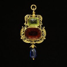 Classic renaissance beauty. Amulet, England, ca. 1540-1560. This pendant of enameled gold, garnet, peridot, and sapphire has a open-backed setting to allow the stones direct contact with the wearer's skin—for very good reason. The alleged healing properties of these specifically-chosen stones and the inscription in the setting were thought to protect the wearer from epilepsy. Source: Victoria and Albert Museum