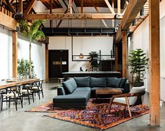 Converted warehouse living space - love the blend of industrial, boho & rustic elements.