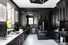 An elegant and glamorous design. All black kitchen cabinets