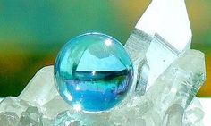 """This is a clear quartz cluster, with an Aqua Aura sphere in front. Clear Quartz is the best general amplifier of energy next to Herkimer Diamond. Aqua Aura is initially clear Quartz, but its been tempered with GOLD & fused at a very high temperature, resulting in the aqua color.  """"Piezoelectric Energy...The Natural Vitality of Quartz"""" ♥ Crystals bestow the ability to generate & regulate energy, which is why but a tiny shard is required in many of the household items we use every day."""