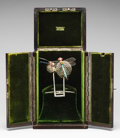 Hair ornament, ca. 1904  Louis Comfort Tiffany (American, 1848–1933)  Silver, enamel, black and pink opals, demantoid garnets