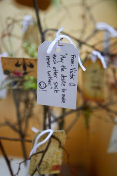 Guests wrote their advice and wishes for our marriage on vintage travel tags, then tied them to a wishing tree.