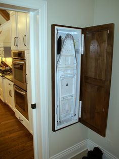 I like this cupboard fold out ironing board for the laundry room