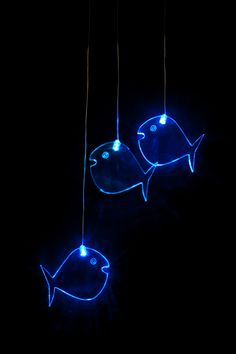 Mobile Fish - 3 x 10mm thick acrylic blowfish shapes each lit by it's own colour changing LED, suspended by micro wire from an acrylic ring and battery pod. Perfect unique gift for baby showers, bithdays & christmas. Full spectrum colour cycle  $39.95