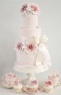 Found on weddingchicks.com vintage style pink wedding cake.