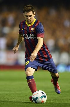 Lionel Messi of Barcelona in action during the La Liga match between Valencia CF and FC Barcelona at Estadio Mestalla on September 1, 2013 in Valencia, Spain.
