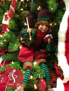 "Sitting Elf - Boy  Size: 18""  Adorable boy elf, sitting position (weighed bottom) all dressed up in red and green, wearing a stocking cap, holding a small car and paint brush.  This item is on order and arriving Summer 2015"