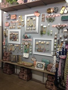 boutique jewelry wall - use a large pegboard to hang all types of products and props off of in a craft fair booth