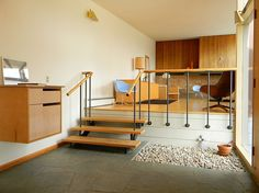 // rock garden + raised sitting room = love Rural Mid-Century Residence by James Cowan