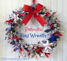 How to make a rag wreath. Obviously could make one for any occasion. Dollar store grape vine wreath, pieces of fabric, jeans and ribbon tied around until it's as full as you want.