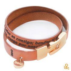"We love this handmade leather bracelet with the words for ""Hail Mary"" in spanish, laser engraved across its double strands! | Nos encanta esta pulsera soble vuelta en cuero hecha a mano, con las palabras del ""Ave María"" grabadas en láser"