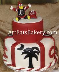 A cake celebrating the University of South Carolina . . . looks awesome . . . & I bet it tastes yummy, too . . .  Go Gamecocks!
