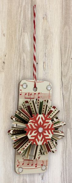 You don't need a craft stash to create chipboard ornaments.  All you need are Glue Dots, chipboard shapes, patterned paper and embellishments.