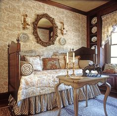Antique French daybeds are perfect for the guest room. Love the toile!