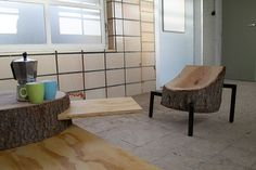 designboom has received this furniture project which captures the essence of reclaimed material.  a series of collected pine logs are turne...