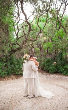 Stunning. lush tropical oasis. perfect gown.    Manasota Beach Club Wedding | Destination Wedding | Sarasota wedding photographer | Sneak Peek » Lauren Bates Photography